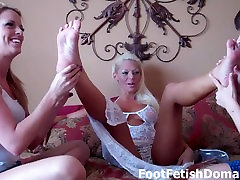 Sexy blonde has her feet worshiped