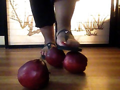 Tiye uses her pretty lounge movei to SMASH 3 apples into pieces!