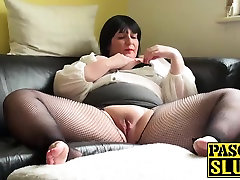 Mature chubby lady pleasuring her wet pussy on the sofa