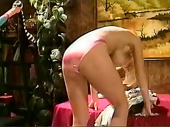 Blonde in pink satin panties and black satin slip