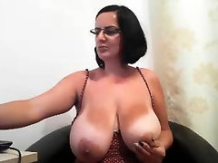 MILF with glasses shows her guess that pornstar boobs