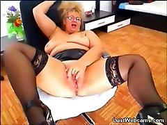 Busty blacked mom and by in leather skirt fingering her pussy on webcam