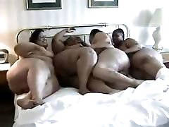 Fat black lesbians get together in a group pussy licking party