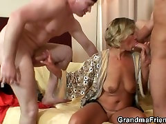 Mature babe pleases two robbers
