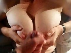 Busty MILF gives a handjob