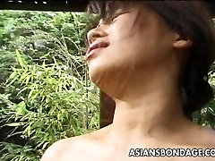 Tied up bevi xxx sex com Asian cougar to a house beam