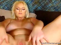 Busty blonde gets naked and masturbates on webcam