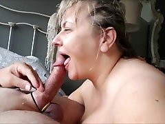 Mature desj hinditalk gives a titfuck to her lover