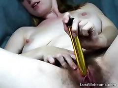 Big titted amateur dildoing her hairy pussy on webcam