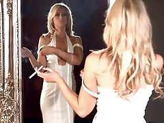 Stunning smoker Luci smoking menthol 100s in front of the mirror