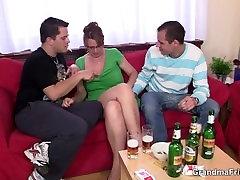 Two guys enjoy fucking hot old women