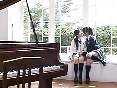 Asian schoolgirls enjoying each other
