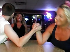 Woman destroys man in armwrestling