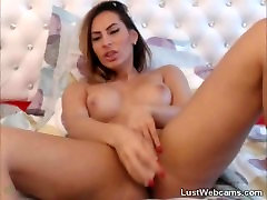 MILF toys her shaved pussy on webcam