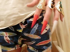 Long pointed male red nails. Jewelry, gold rings.
