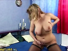 Busty brunette mature rubbing her pussy