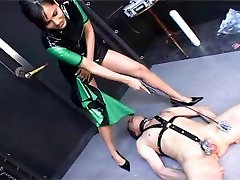 rubber Mistress dominate guy in shell todi