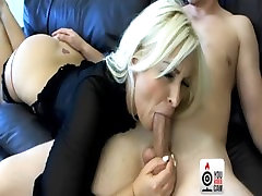 blonde is sucking cock, deep throat while masturbating on camera look