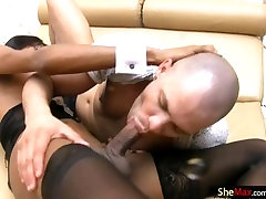 Black T-girl with black hair sucks cock in 69 before fucking