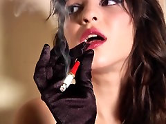 Sexy Babe Smokes Seductively for Your Amusement