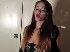 Sexy Brunette in Black Stockings and Garters Blows Smoke from Sexy Mouth