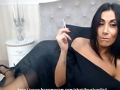 Sexy black-haired MILF smoking a capri 120s cigarette