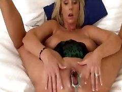 Curvaceous mommy with pierced nipples takes enormous toys
