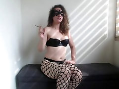 bounce bouncing tit small cigar, wearing my fishnet pantyhose I rub my clit.