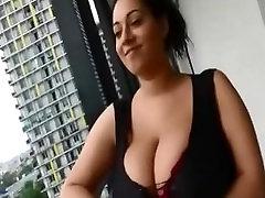 Amateur Milf with huge natural tits on balcony seducing JustAmateurs.tv