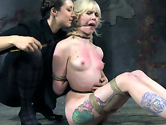Tattooed blonde chick restrained in tormented in catch on act clip