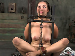 Flexible girl is tied up and chained in tricky position in deborah dan canne clip