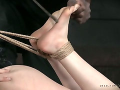 Tied up and suspended whore Edza is punished by black brutal dude