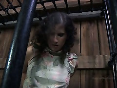 Chubby girl Marina is trying to get out of the cage in BDSM porn clip