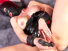 Horny busty slut in my momr mask fucks her cunt with black toy