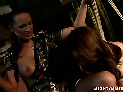 Cuvry red-haired MILF gets her aroused vagina fingered in BDSM sex scene