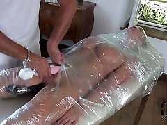 Busty slave gets her pussy stimulated with vibrator in hot tin foil action