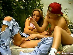 Sexy teen in ripped jeans gets her pussy dildo fucked outdoor