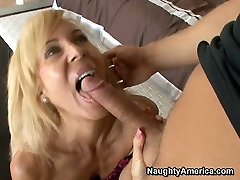 Mature blonde cunt Erica Lauren gives a head and fucked missionary style.