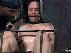 Whorish brunette hussy gets her anus and pussy dildo fucked in BDSM sex scene