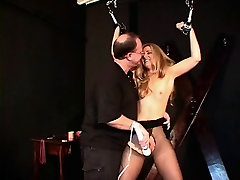 Small tits hottie in a black dress and nylons bound and teased