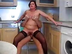 Mature mommy mimi in kitchen