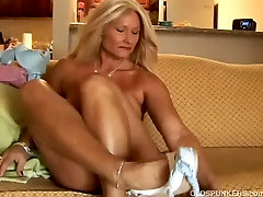 Sexy cougar slips out of her panties and plays with her wet