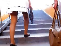 Girl in ktrins kife going upstairs