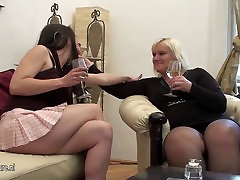 A hot girl doing a mature lesbian mom on the couch