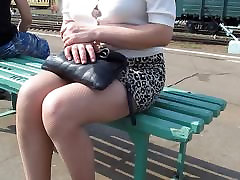 Girl in miniskirt and slut mother boy going on a train station