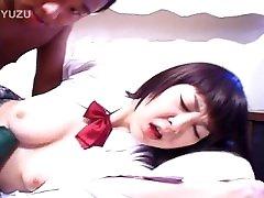 Young Asian in schoolgirl skirt