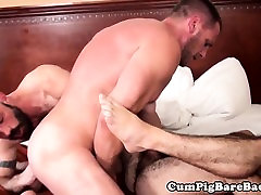 Ripped bear barebacking in muscle threesome