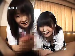 Two beautiful Asian schoolgirls blowing and stroking a dick