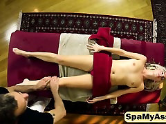 Sensual blonde gets tight pussy licked on massage table