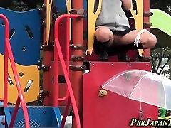 Asian pisses in umbrella